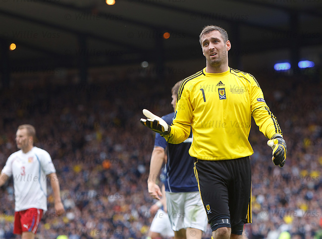 Allan McGregor appeals in vain after Scotland were awarded a penalty against them in the final minute