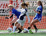 (Brockton MA 11/14/15) Medway 20, Isabella Aviza, center, kicks the ball in for what would turn out to be the winning goal in the 1-0 contest, as Dover-Sherborn 20, Graydon Wood, left, and 16, Olivia Maier, are unable to stop her,  during  the division three south girls soccer final, Saturday, November 14, 2015, at Brockton High School. Herald Photo by Jim Michaud