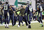 Seattle Seahawks  head coach Pete Carroll greets his kickoff coverage team as they come off the field against the Arizona Cardinals at CenturyLink Field in Seattle, Washington on November 15, 2015. The Cardinals beat the Seahawks 39-32.   ©2015. Jim Bryant photo. All Rights Reserved.