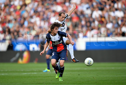 31.08.2013. Paris, France. French League football. Paris St Germain versus Guingamp Aug 31st.  Adrien Rabiot (psg) - Thibault Giresse (gui)