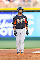 Alexi Casilla (12) of the Norfolk Tides takes his lead off of second base against the Charlotte Knights at BB&T Ballpark on May 21, 2014 in Charlotte, North Carolina.  The Tides defeated the Knights 10-3.  (Brian Westerholt/Four Seam Images)