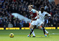Pictured: Nathan Dyer of Swansea (R) challenged by a West Ham player. 01 February 2014<br />