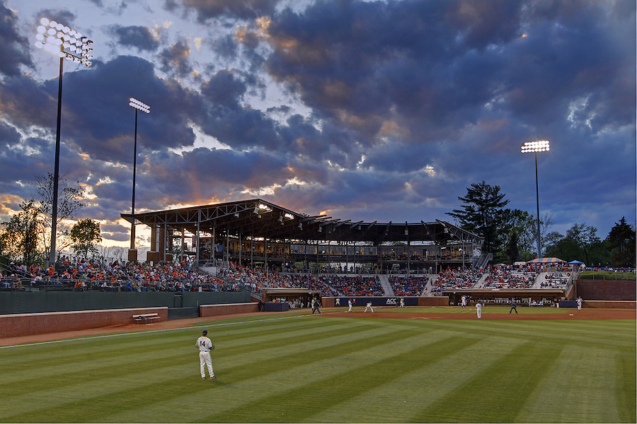 The sky behind Davenport Stadium lights up with a colorful sunset as Virginia took on Wake Forest in the final game of a 3-game series Monday night in Charlottesville, Va. Photo/Andrew Shurtleff