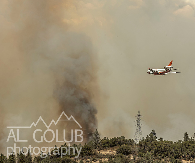 -Rim Fire-  DC 10 Air Tanker makes retardant drop close to Hetch Hetchy Power lines near Big Creek just east of Groveland.