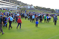 The massive crowds invade the 18th hole of after Graeme McDowell wins in the last match during the Final Day of the The 2010 Ryder Cup at the Celtic Manor, Newport, Wales, 3rd October 2010..(Picture Eoin Clarke/www.golffile.ie)