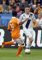 CARSON, CA - DECEMBER 01, 2012:   Robbie Keane (7) of the Los Angeles Galaxy moves in on Corey Ashe (26) of the Houston Dynamo during the 2012 MLS Cup at the Home Depot Center, in Carson, California on December 01, 2012. The Galaxy won 3-1.
