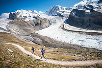 Trail running above Zermatt, Switzerland with the Monte Rosa in the background.