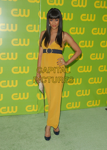 TIA MOWRY.The CW Launch Party held at Warner Brothers' Studios in Burbank, California, USA..September 18th, 2006.Ref: DVS.full length yellow dress blue belt hand on hip.www.capitalpictures.com.sales@capitalpictures.com.©Debbie VanStory/Capital Pictures
