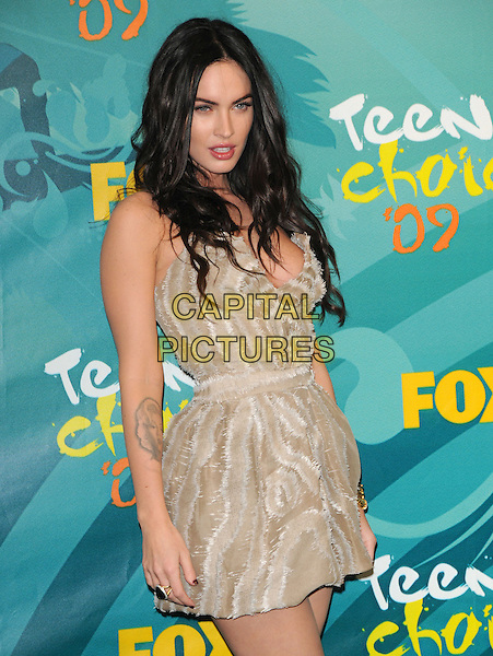 MEGAN FOX.Teen Choice Awards 2009 - Press Room held at the Gibson Amphitheatre, Universal City, CA, USA .August 9th, 2009 .pressroom half length gold beige cleavage low cut mini dress tattoo .CAP/DVS.©Debbie VanStory/Capital Pictures.