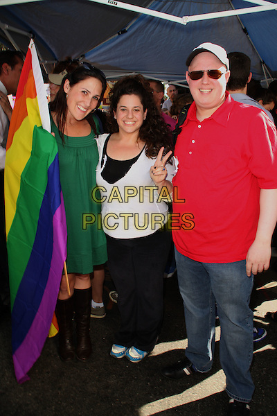 RIKKI LAKE, MARISSA JARET WINOKUR & MATT LUCAS protest against Proposition 8.No on Prop 8 Protest Rally held at City Hall, Los Angeles, California, USA, .15 November 2008..Gay marriage civil rights politics political protest atmosphere Full length green dress white top black knee high boots sign rainbow flag red t-shirt jeans cap hat sunglasses .CAP/ADM/KB.©Kevan Brooks/Admedia/Capital PIctures