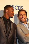 Loving's Michael Weatherly with castmate Chris Jackson - Bull - CBS Upfront 2016 - Oak Room, New York City, New York.  (Photo by Sue Coflin/Max Photos)