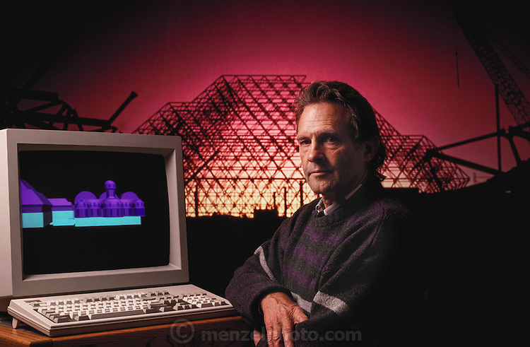 USA_SCI_BIOSPH_81_xs <br /> Biosphere 2 Project undertaken by Space Biosphere Ventures, a private ecological research firm funded by Edward P. Bass of Texas.  Architect Philip Hawes at a computer workstation, with Biosphere construction on his computer and projected onto the background.  Biosphere 2 was a privately funded experiment, designed to investigate the way in which humans interact with a small self-sufficient ecological environment, and to look at possibilities for future planetary colonization. The $30 million Biosphere covers 2.5 acres near Tucson, Arizona, and was entirely self- contained. The eight &lsquo;Biospherian&rsquo;s&rsquo; shared their air- and water-tight world with 3,800 species of plant and animal life. The project had problems with oxygen levels and food supply, and has been criticized over its scientific validity. 1990