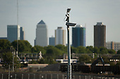 Security camera in the Olympic Park, Stratford, and Canary Wharf towers.