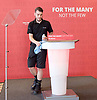 Jeremy Corbyn, Leader of the Labour Party speech on defending democracy and the importance of standing together in solidarity with the city of Manchester.<br /> 26th May 2017 Westminster, London. Great Britain <br /> <br /> final touches as operative cleans the lectern before <br /> Jeremy Corbyn arrives on stage <br /> <br /> <br /> Photograph by Elliott Franks <br /> Image licensed to Elliott Franks Photography Services
