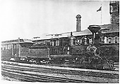 3/4 frontal view of C&amp;S #9 with a passenger train at Denver Union Station.  Engine has smoothed domes before rebulding by Cooke.<br /> C&amp;S  Denver, CO  prior to 4/1901