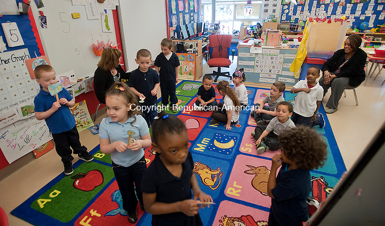 WATERBURY, CT-050214JS01--Students in a pre-kindergarten class at Duggan Elementary School in Waterbury, play during class at the school on Friday. The State of Connecticut has seen and expansion of the pre-kindergarten program. <br /> Jim Shannon Republican-American