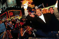 (011211-SWR02.jpg) - NEW YORK, NY - FILE PHOTO - An African American man in a top hat cheers among a crowd of tourists who gathered in Times Square to welcome in the New Year. The annual New Years Eve celebration draws hundreds of thousands of tourists and New Yorkers to the Great White Way...Photo © Stacy Walsh Rosenstock