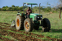 ZAMBIA, Mazabuka, farm of medium scale farmer Stephen Chinyama , he practise conservation farming, ripping furrows with John deere Tractor to sow cotton seeds, ripping protects the soil instead of ploughing