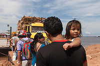 Amazon people portrait, family waits in line for taking ferry-boat, Manaus city, north Brazil.