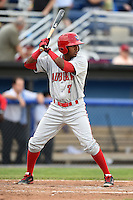 Auburn Doubledays shortstop Osvaldo Abreu (7) at bat during a game against the Batavia Muckdogs on June 16, 2014 at Dwyer Stadium in Batavia, New York.  Batavia defeated Auburn 4-3.  (Mike Janes/Four Seam Images)