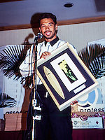"Sunny Garcia (HAW)  with the 1990 ASP ""Most Improved"" award at the ASP Awards banquet  in Hawaii. Photo: joliphotos.com"