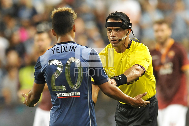 Sporting Park, Kansas City, Kansas, July 31 2013:<br /> Referee Hilario Grajeda wearing camera on head band moves DeAndre Yedlin back.<br /> MLS All-Stars were defeated 3-1 by AS Roma at Sporting Park, Kansas City, KS in the 2013 AT &amp; T All-Star game.