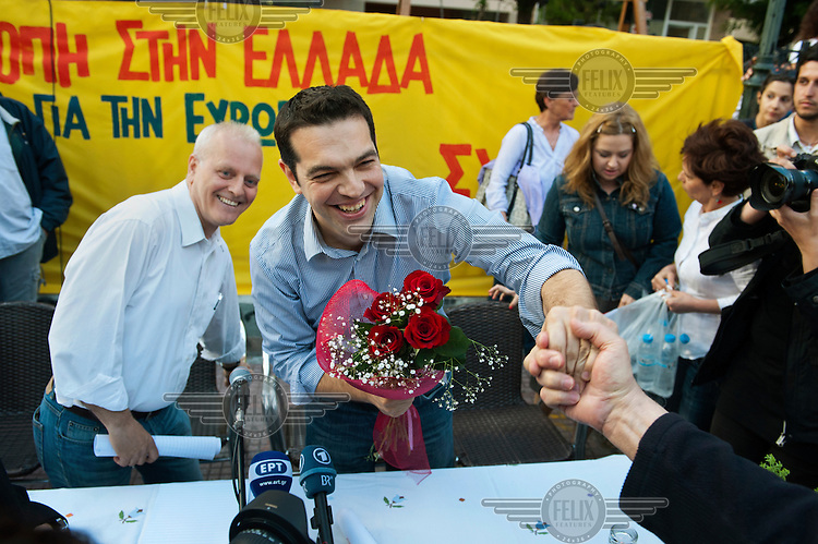 Opposition party Synasmispos president Alexis Tsipras speaks to members of the crowd at the Assembly of SYRIZA (the Coalition of the Radical Left parliamentary group, of which he is the head) in Aghia Ekaterini Square, in the Kato Petralona neighbourhood  of Athens.