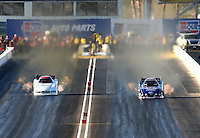 Feb 21, 2014; Chandler, AZ, USA; NHRA funny car driver Robert Hight (right) races alongside Paul Lee during qualifying for the Carquest Auto Parts Nationals at Wild Horse Pass Motorsports Park. Mandatory Credit: Mark J. Rebilas-USA TODAY Sports