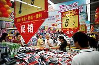 Shoppers look through a discount bin on a busy shopping day at the Trust-Mart supermarket in Nanjing, China.