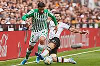 29th February 2020; Mestalla, Valencia, Spain; La Liga Football,Valencia versus Real Betis; Nail Fekir of Real Betis skips the tackle from Jose Gaya of Valencia CF