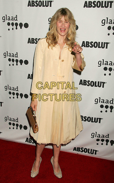 LAURA DERN.The 17th Annual GLAAD Media Awards - Arrivals..Los Angeles, California, USA,.8 April 2006.full length yellow dress coat gold bag pointing gesture.Ref: ADM/RE.www.capitalpictures.com.sales@capitalpictures.com.©Russ Elliot/AdMedia/Capital Pictures.