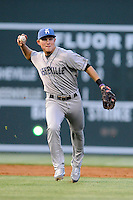 Shortstop Patrick Valaika (16) of the Asheville Tourists fields a grounder in a game against the Greenville Drive on Monday, April 21, 2014, at Fluor Field at the West End in Greenville, South Carolina. Greenville won, 8-3. (Tom Priddy/Four Seam Images)