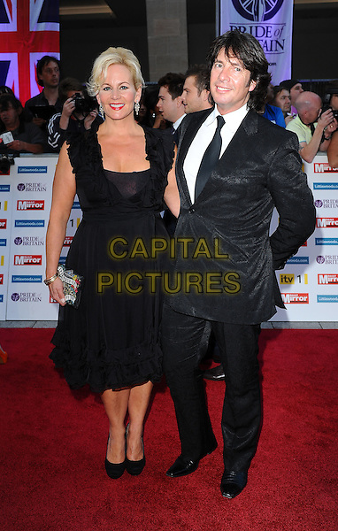 Jackie & Laurence Llewelyn-Bowen.'The Daily Mirror's Pride Of Britain Awards 2011' at Grosvenor House Hotel, London, England..3rd October 2011.full length black suit dress married husband wife .CAP/BEL.©Tom Belcher/Capital Pictures.