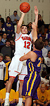 SIOUX FALLS, SD - JANUARY 21:  Brett Stanley #12 from Washington spots up for a jumper over Trevor Jutting #24 from Watertown in the first half of their game Tuesday night at Washington. (Photo by Dave Eggen/Inertia)