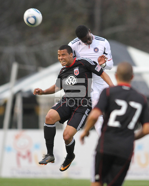 Charlie Davis#9 of D.C. United loses a header to Jalil Anibaba#6 of the Chicago Fire during a second round match of the Carolina Challenge on March 9 2011 at Blackbaud Stadium, in Charleston, South Carolina. D.C. United won 1-0.