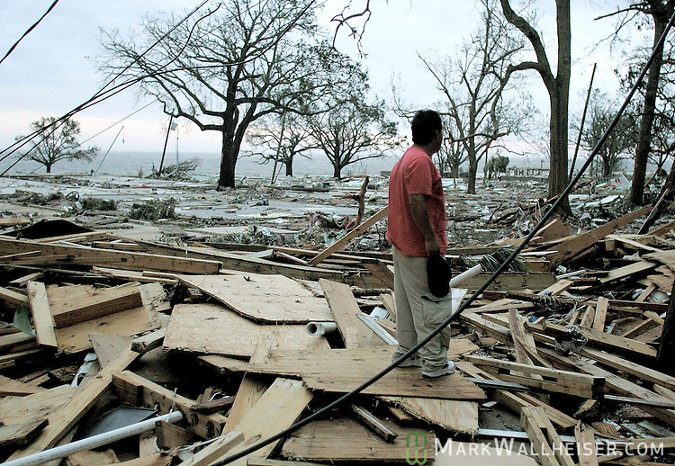 David Diaz looks over the area where he and his brother used to live in the Sadler Apartments on the waterfront in Biloxi, Mississippi August 29, 2005.  The pile of rubble and empty foundations are where once 30 or more apartments and over 100 of the St. Charles Condominiums. Over 30 of his neighbors that stayed during the hurricane were feared lost.   Hurricane Katrina completely devistated Biloxi Mississippi and much of the gulf coast of Mississippi and Lousisana.