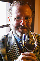 Juan Luis Bouza, owner, tasting a glass of wine. Bodega Bouza Winery, Canelones, Montevideo, Uruguay, South America
