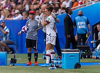 LYON,  - JULY 7: Carli Lloyd #10 talks to Graeme Abel during a game between Netherlands and USWNT at Stade de Lyon on July 7, 2019 in Lyon, France.