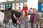 Three generations at the Castleisland Horse fair on Friday Timothy Hickey Cordal gives his grandson Emett a ride on his horse helped by his daughter Annette