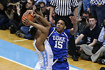 07 March 2015: Duke's Jahlil Okafor (15) ties up the ball with North Carolina's Kennedy Meeks (left). The University of North Carolina Tar Heels played the Duke University Blue Devils in an NCAA Division I Men's basketball game at the Dean E. Smith Center in Chapel Hill, North Carolina. Duke won the game 84-77.