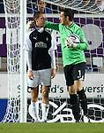 Aberdeen keeper Jamie Langfield hugs Falkirk striker Kjartan Finnbogason after a near miss