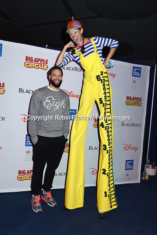 Deron Williams from the Brooklyn Nets and stilt walker   attends the Hospital for Special Surgery's 8th Annual  Big Apple Circus Benefit on December 6, 2014 at Damrosch Park in Lincoln Center  in New York City, USA.<br /> <br /> photo by Robin Platzer/Twin Images<br />  <br /> phone number 212-935-0770