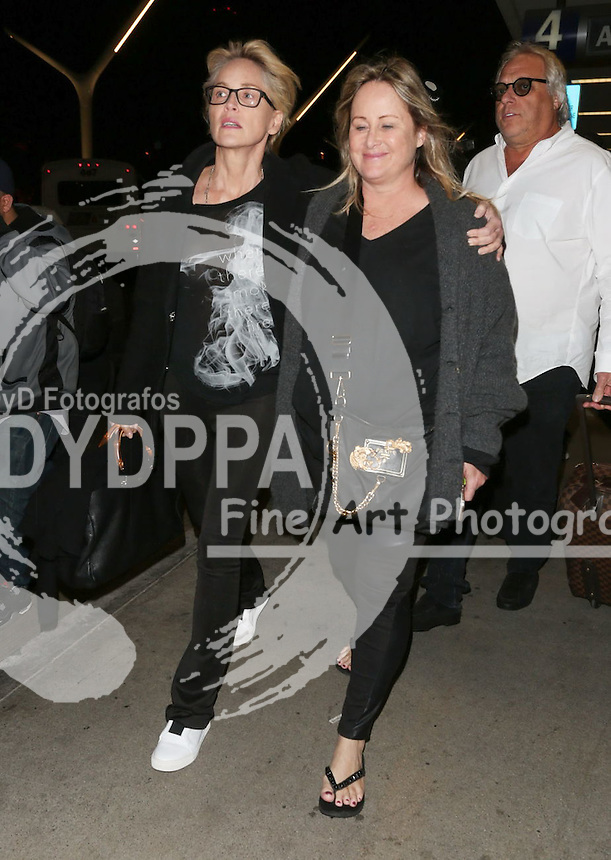 **ALL ROUND PICTURES FROM SOLARPIX.COM**<br /> **SOLARPIX RIGHTS - UK, AUSTRALIA, DENMARK, PORTUGAL, S. AFRICA, SPAIN &amp; DUBAI (U.A.E) &amp; ASIA (EXCLUDING JAPAN) ONLY**<br /> Caption:<br /> Sharon Stone Sighted Arriving at LAX Airport in LA<br /> This pic:Sharon Stone <br /> **STRICTLY NO ONLINE USAGE WITHOUT PRIOR AGREEMENT**<br /> JOB REF: 18783    PHZ/JMX  DATE:10.11.15<br /> **MUST CREDIT SOLARPIX.COM AS CONDITION OF PUBLICATION**<br /> **CALL US ON: +34 952 811 768**