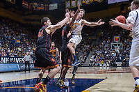 California's Ricky Kreklow passes the ball to Kameron Rooks during a game against USC at Haas Pavilion in Berkeley, California on February 23th, 2014. California defeated USC 77 - 64