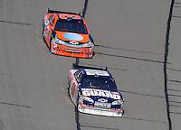 Sept. 28, 2008; Kansas City, KS, USA; Nascar Sprint Cup Series driver Dale Earnhardt Jr leads Jeff Burton during the Camping World RV 400 at Kansas Speedway. Mandatory Credit: Mark J. Rebilas-