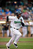 Dayton Dragons right fielder Michael Beltre (34) runs to first base during a game against the Cedar Rapids Kernels on May 10, 2017 at Fifth Third Field in Dayton, Ohio.  Cedar Rapids defeated Dayton 6-5 in ten innings.  (Mike Janes/Four Seam Images)