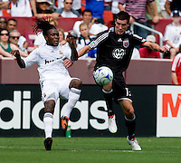 Real Madrid defender (15) Royston Drenthe clears the ball away from  DC United midfielder (13) Chris Pontius during their friendly at FedEx Field in Landover, Maryland.  Real Madrid defeated DC United, 3-0.