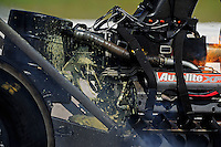 Aug. 20, 2011; Brainerd, MN, USA: Detailed view of oil spilling from the engine of the car of NHRA top fuel dragster driver Scott Palmer during qualifying for the Lucas Oil Nationals at Brainerd International Raceway. Mandatory Credit: Mark J. Rebilas-