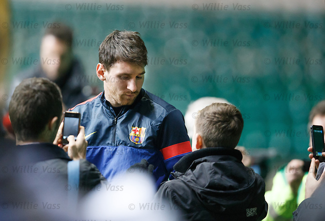 Lionel Messi arrives trackside for training