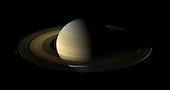 """Of the countless equinoxes Saturn has seen since the birth of the solar system, this one, captured here in a mosaic of light and dark, is the first witnessed up close by an emissary from Earth ... none other than our faithful robotic explorer, Cassini.  Seen from our planet, the view of Saturn's rings during equinox is extremely foreshortened and limited. But in orbit around Saturn, Cassini had no such problems. From 20 degrees above the ring plane, Cassini's wide angle camera shot 75 exposures in succession for this mosaic showing Saturn, its rings, and a few of its moons a day and a half after exact Saturn equinox, when the sun's disk was exactly overhead at the planet's equator. The novel illumination geometry that accompanies equinox lowers the sun's angle to the ring plane, significantly darkens the rings, and causes out-of-plane structures to look anomalously bright and to cast shadows across the rings. These scenes are possible only during the few months before and after Saturn's equinox which occurs only once in about 15 Earth years. Before and after equinox, Cassini's cameras have spotted not only the predictable shadows of some of Saturn's moons, but also the shadows of newly revealed vertical structures in the rings themselves.  Also at equinox, the shadows of the planet's expansive rings are compressed into a single, narrow band cast onto the planet as seen in this mosaic.  The images comprising the mosaic, taken over about eight hours, were extensively processed before being joined together. First, each was re-projected into the same viewing geometry and then digitally processed to make the image """"joints"""" seamless and to remove lens flares, radially extended bright artifacts resulting from light being scattered within the camera optics..At this time so close to equinox, illumination of the rings by sunlight reflected off the planet vastly dominates any meager sunlight falling on the rings. Hence, the half of the rings on the left illuminated by planetsh"""